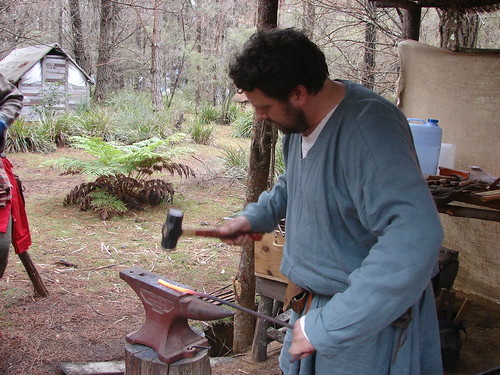 Adam impersonating a blacksmith