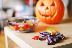 Happy Bokeh Halloween (Inside_man) Tags: stilllife colorful candy bokeh chocolate snickers kitkat crunch butterfinger carvedpumpkin glassbowl sooc halloween2008 happybokehhalloween
