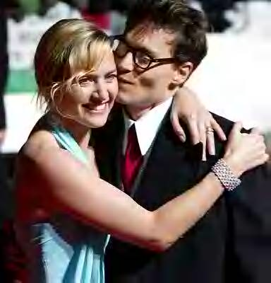 Kate Winslet and Johnny Depp. Johnny gives Kate a kiss at the London