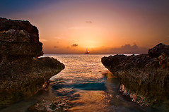 Malmok Beach Sunset (rseidel3) Tags: ocean sunset sun beach water clouds island boat waves aruba limestone westside hdr malmok