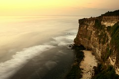 ombak (Farl) Tags: longexposure travel sunset sea bali cliff colors indonesia temple twilight surf waves dusk horizon religion indianocean uluwatu hinduism jimbaran