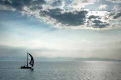 Greece - Aegina - Boat silhouette (Darrell Godliman) Tags: travel sea sky copyright travelling tourism silhouette ferry clouds boat nikon europe sailing ship yacht transport eu greece gr d200 greekislands epic fullsail allrightsreserved egina aegina islandhopping saronicgulf travelphotography nikond200 instantfave 5photosaday omot  saronicislands travelphotographer diamondclassphotographer flickrdiamond flickrelite dgphotos darrellgodliman wwwdgphotoscouk dgodliman cloudsstormssunsetssunrises