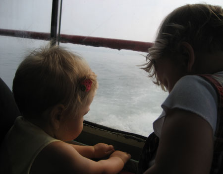 Eva and her friend H checking out the view from the back of the ferry