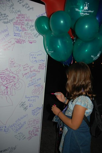 Signing Miley's giant card