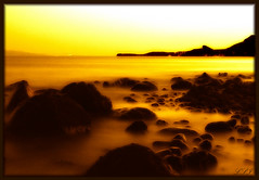 Butterscotch World (Kuzeytac) Tags: longexposure travel light sunset sea sky orange brown sun color colour nature wet silhouette yellow stone turkey geotagged gold golden scenery view postcard trkiye turkiye aegean wave scene explore geotag siluet deniz leyla assos gkyz ege manzara gnbatm gne sar lsi k dalga portakal renk akam doa tabiat ta anakkale altn kahverengi canoneos400d canoneosdigitalrebelxti ayvack rainbowseries colorphotoaward friendlychallenges fractalius kuzeytac aqualityonlyclub