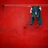 1319 (s▲ul gm) Tags: red muro portugal wall pared rojo lisboa lisbon trousers pantalones clothesline lissabon alfama tendal pantalón explore12 saulgm artlibre ltytr2 ltytr1 ltytr3 artlibres top20red