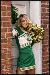 Bailee- Class of '09 (teacherholly) Tags: school portrait urban brick senior beautiful smile pose grit alley pretty skirt blonde cheer cheerleader 2009 pompoms seniorphoto classof2009 bailee seniorportrait greenandgold classof09 amherstcomets seniors09 cheerleadingskirt