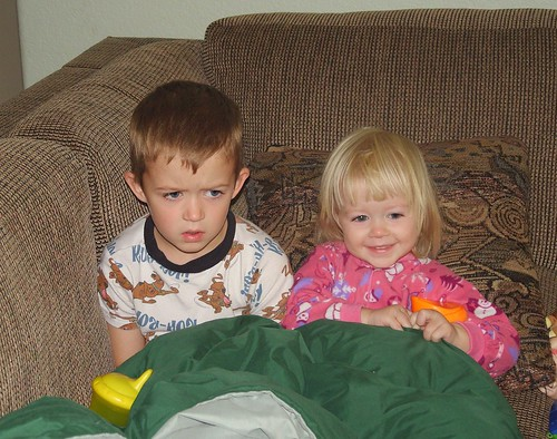 brother and sister watching cartoons...