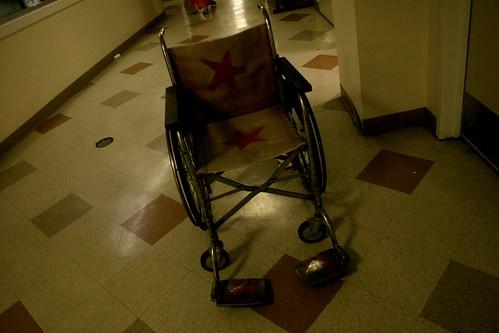 wheelchair outside pool hall