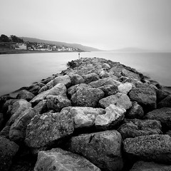 Lyme Regis Inner Breakwater (Adam Clutterbuck) Tags: ocean uk greatbritain sea england blackandwhite bw seascape monochrome rock square landscape mono coast pier blackwhite rocks harbour bn boulders coastal shore elements dorset gb cobb bandw southcoast sq oe lymeregis lyme regis breakwater thecobb jurassiccoast greengage adamclutterbuck sqbw bwsq showinrecentset openedition