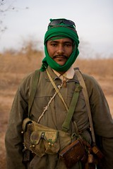Meet The Janjaweed-13.jpg (Andrew Carter) Tags: sunglasses fighter sudan headscarf moustache arab conflict militia darfur pouches janjaweed unreportedworld