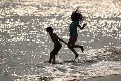 Beach Children (mrhayata) Tags: park sea sunlight beach silhouette japan children geotagged tokyo bay blog seaside 日本 東京 海 edogawa kasai 波 少女 シルエット 江戸川区 葛西臨海公園 東京都 東京湾 砂浜 少年 mrhayata lightofsummer geo:lat=356382322 geo:lon=1398549397