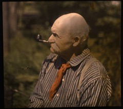 Mustached man smoking pipe (George Eastman House) Tags: old braces stripes smoke pipe bald smoking age stripedshirt georgeeastmanhouse autochrome  photo:process=colorplatescreenautochromeprocess color:rgb_avg=453423 geh:accession=197801700010