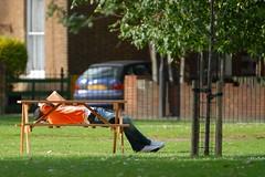 Reading in the park (jeremyhughes) Tags: park uk orange man london sunshine bench outdoors reading nikon afternoon leisure hackney d200 nikkor relaxation londonfields orangejacket nikond200
