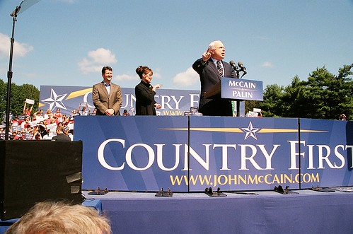 John Mc Cain and Sarah Palin with a huge banner Country First