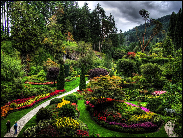 Two people visit Butchart Gardens on a cloudy day and stand motionless long enough for a 5x HDR