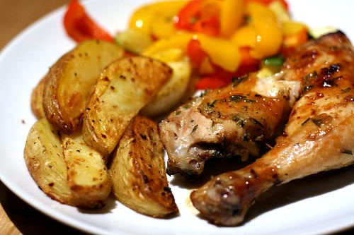 Rosemary chicken legs with potato wedges and roasted peppers