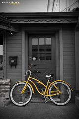 The Yellow Cycle (djniks) Tags: bw bicycle wheel yellow town washington cycle coloring wa leavenworth bavarian selective selectivecoloring sigma1020 canon40d