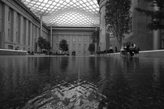 Kogod Courtyard BW2 (christaki) Tags: bw water glass architecture washingtondc steel wideangle dcist canopy npg 1022mm nationalportraitgallery dcnw dcmuseum wpblog kogodcourtyard