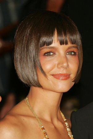 katie holmes short hairstyle. Short hair will make you look