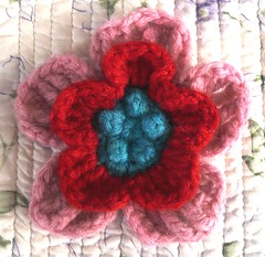 pink red and aqua crochet flower
