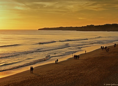 seashore stroll (julioc.) Tags: ocean sunset sea sky people beach portugal water backlight walking lumix fz20 golden evening mar agua waves walk shoreline scenic cu dourado coastal getty backlit copyspace algarve stroll seashore atmospheric contrejour goldenhour passeio gettyimages oceano armaodepra dmcfz20 bigmomma peoplewalking julioc largegroupofpeople flickrsbest photographybyjulioctheblog favescontestwinner photofaceoffplatinum a3b ilustrarportugal srieouro cyspecialchallenge2nd tmoacawardwinner j7599 mostbeautifulbeaches