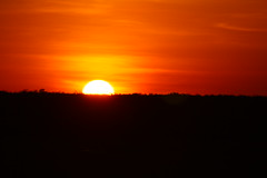 Sunset - seen from Ubirr (Steffen und Christina) Tags: sunset red sun yellow 1 wasser sonnenuntergang nt horizon wolken australia australien sonne horizont kakadunationalpark ubirr nothernterritory tamronaf28300mmf3563xrdildasphericalifmacro