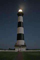 Bodie Island Lighthouse by moon light (MNesterpics) Tags: sky lighthouse building stars nc northcarolina nighttime moonlight 2008 outerbanks obx bodieislandlighthouse bodieisland amazingamateur theunforgettablepictures proudshopper