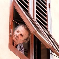 Outlook (Dean Ayres) Tags: italy woman window lady italia tuscany shutter sangimignano toscana