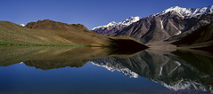 Chandertal lake, Spiti (sapru) Tags: blue sky mountain lake reflection trek reflections landscape still cool fantastic quiet peace horizon lakes relaxing restful calming surreal floating peaceful tranquility calm silence harmony serenity serene dreamlike hush stillness tranquil himachal himalayas balanced poised spiti gentle soothing calmness treks quietness comforting himachalpradesh composed otherworldly illusory unruffled chandertal untroubled flickrsbest unperturbed lahaul chandrataal lahualspiti lahual unworried indianhimalayas trancelike unlimitedphotos natureselegantshots lahualandspiti lakesinhimachal treksinhimachal magicunicornverybest