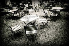 All gone... (manganite) Tags: bw white black monochrome contrast digital germany dark geotagged bayern bavaria high nikon europe mood chairs tl framed empty atmosphere parasol tables d200 nikkor dslr vignette irsee 18200mmf3556 utatafeature manganite nikonstunninggallery repost1 date:year=2008 date:month=september date:day=17 klosterirsee shunshades geo:lat=47910801 geo:lon=10574877 format:ratio=32