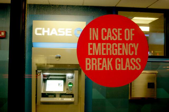 'In case of emergency break glass' sticker on glass