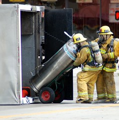 Los Angeles Firefighters handle a leaking cryogenic container. © Photo by Mike Meadows. Click to view more...