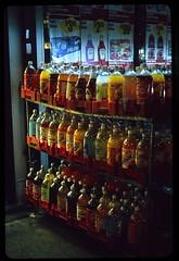 (andre dos santos) Tags: street nyc newyorkcity urban newyork film night zeiss 35mm landscape bottle fuji harlem manhattan slide supermarket upper chrome fujifilm soda provia planar 400iso 2liter hamiltonheights uppermanhattan push2 contaxg 400x twoliter provia400x