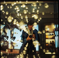 (hurtingbombz) Tags: light urban selfportrait reflection 120 6x6 film glass night hongkong asia tl kodakportra400vc bubbles mf f28 80mm pentaconsix czj carlzeissjena biometar