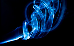 Smokey (Leo Druker) Tags: blue abstract slr fire 50mm nikon spirals smoke flash burning flame burn match sparks incense 50mm18 d300 externalflash offcameraflash strobist