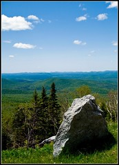 Whiteface 4: Rock and Rolling (Tony Fischer Photography) Tags: road blue sky mountain ny newyork green nature rock clouds high biker elevation whiteface lakeplacid whitefacemountain