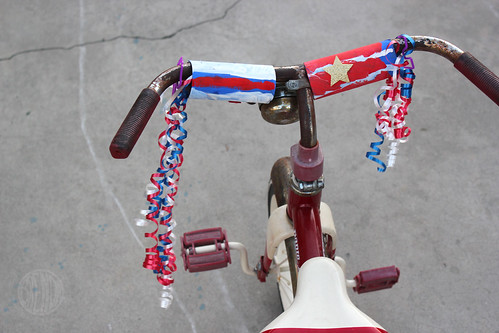 Patriotic streamers attached to bicycle handles