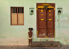 Girl and door in Puducherry, India (Eric Lafforgue) Tags: door woman india green window girl wall female democracy child femme indie indi fille indien tamil hind indi inde pondichery hodu southasia indland  hindistan indija   ndia hindustan   lafforgue   ericlafforgue hindia puducherry  bhrat 702404  indhiya bhratavarsha bhratadesha bharatadeshamu bhrrowtbaurshow  hndkastan