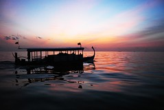 A Sunset Ride (nattu) Tags: ocean travel sunset shadow sun reflection beach water silhouette set transportation maldives nattu