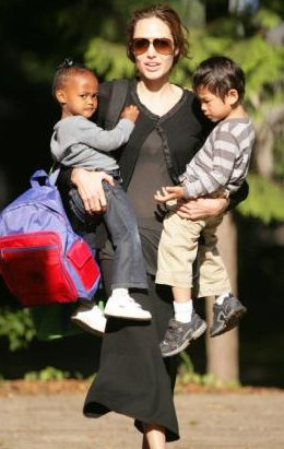 Angelina Jolie Carries Two Sons
