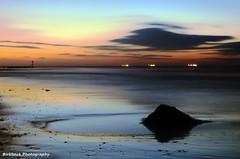 Dying light (~Glen B~) Tags: pink blue sea orange black beach yellow night coast sand tide ships shore groyne rockpool redcar groynes