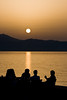 Enjoy the sunset (macropoulos) Tags: sunset sea summer people topf25 geotagged golden 500v20f silhouettes greece crete uc heraklion canonef100mmf28macrousm abigfave canoneos400d 30faves30comments300views infinestyle goldenphotographer ysplix top20sunsetsofourhearts geo:lat=35342395 geo:lon=25130582 gettygreecesummer