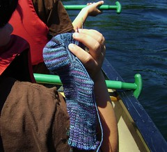 black magic woman canoeing on the lake