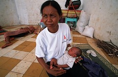 A mother living with her baby on the street (World Bank Photo Collection) Tags: poverty family woman baby holding infant asia cambodia child mother hold worldbank eastasia