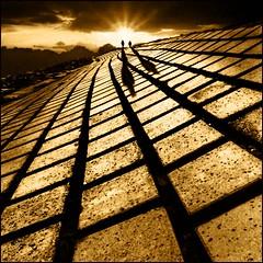 Follow the yellow brick road! (adrians_art) Tags: uk light sunset england people sun lines dark evening shadows squares silhouettes sunburst themoulinrouge 500x500 mywinners platinumphoto aplusphoto winner500 saariysqualitypictures
