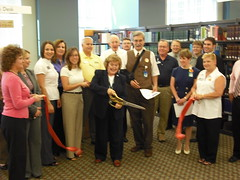 Library Director Marcia Au cuts the ribbon opening Business Central