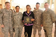 U.S. Rep. Karen Bass with members of the Armed Forces