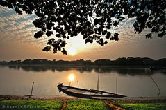 Lonely Sunset (Rezwan Razzaq) Tags: blue sunset sky sun reflection nature water river landscape dawn golden boat nikon alone wide ultrawide bangladesh lonesome gettyimagesbangladeshq2