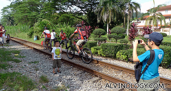 Spotted cyclists riding along the railway track
